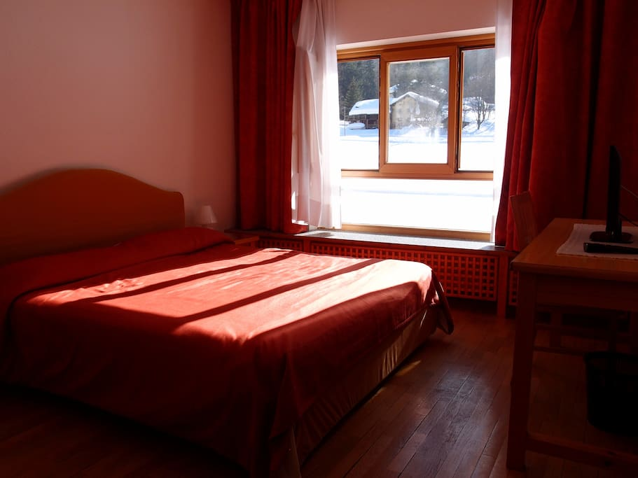 Double bed room, view on meadow and mountains