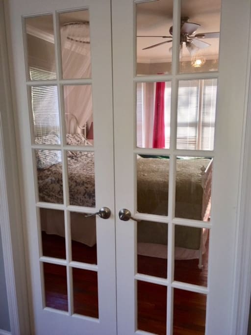 French doors with curtains for privacy between rooms.