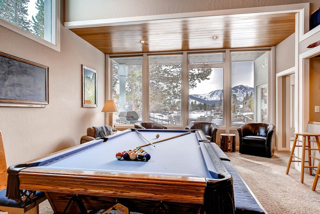 When you walk through the door, you see straight through the windows. The pool table has custom top for a table for 12