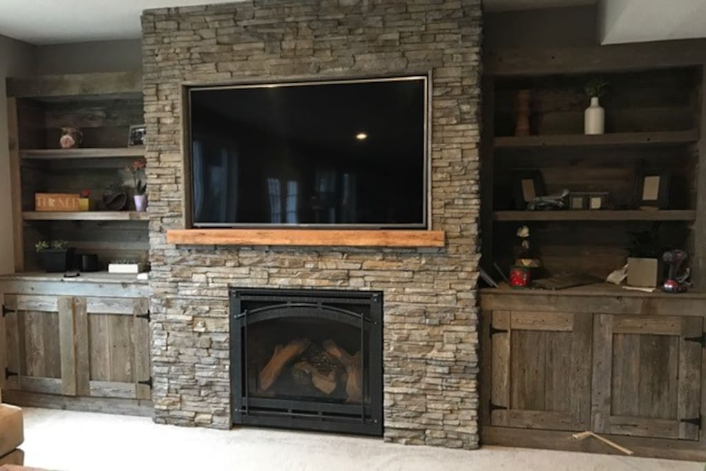 "Beautiful stone gas fireplace with 65"" HD TV.  Direct TV with HBO."