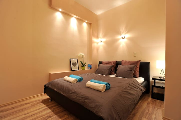 This is the second bedroom with a queen size bed that also has a private french balcony.