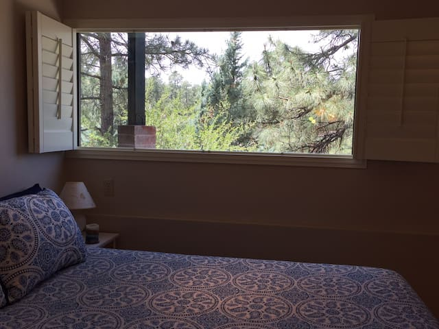 """The view from your comfy queen bed with 14"""" memory foam mattress atop a pine platform frame.  Let the stress of the day melt away!"""
