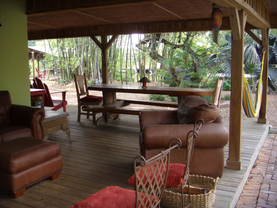 Covered veranda, dining table and hammock