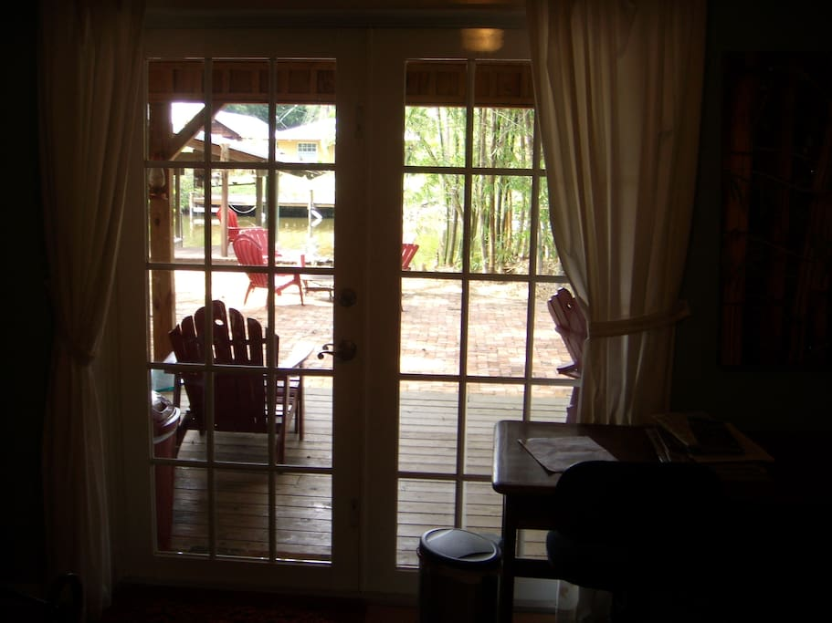 Looking out to back yard and veranda from the bed.