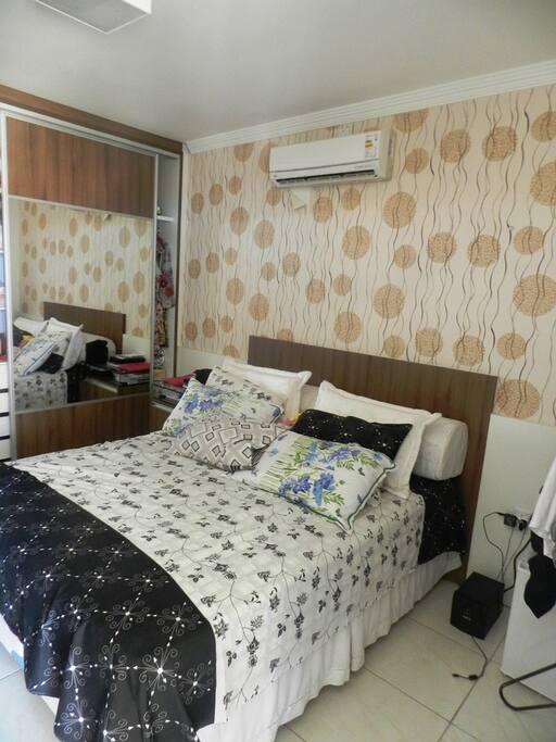 Suite com Ar condicionado, frigobar e Varanda