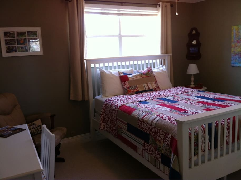 Bedroom with queen bed and writing desk