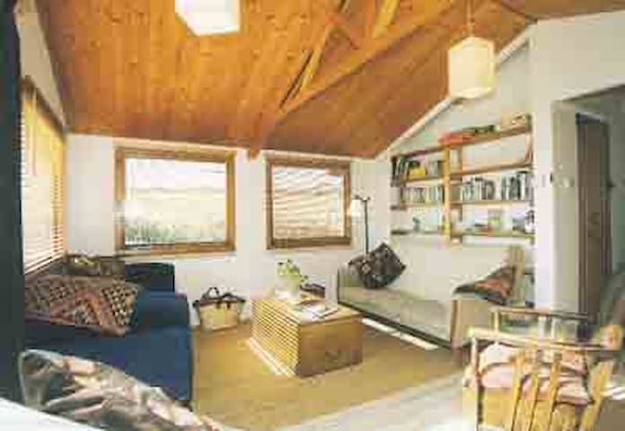 Comfortable and spacious lounge with access onto decking area.