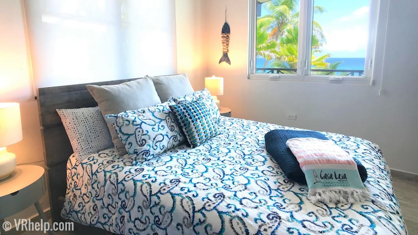The master, with queen bed, also features that huge ocean view.