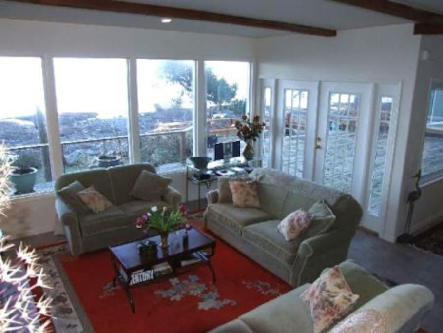 Living room and porch.  View of the water