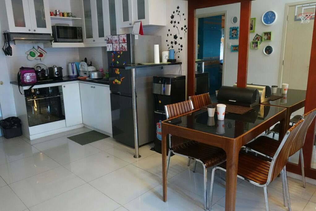 The kitchen and dining area with complete utensils for 4 persons