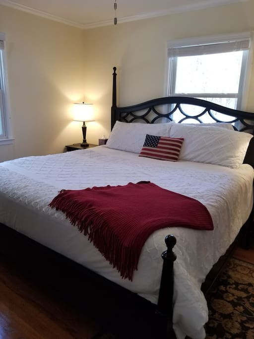 Beautiful, comfortable king size bed in master bedroom