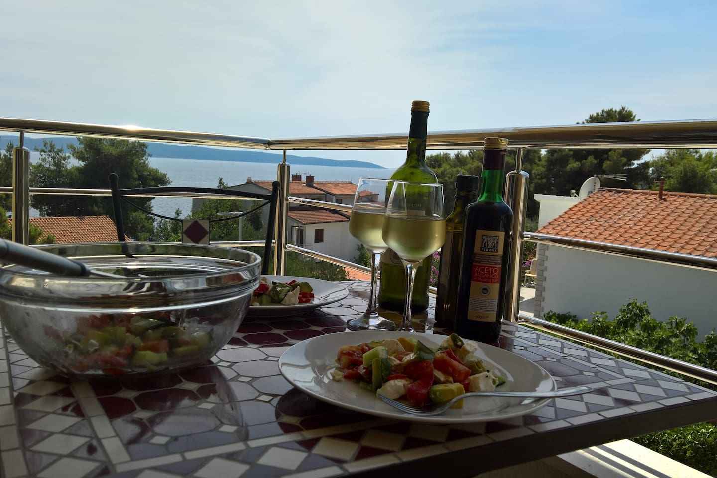 The view from the balcony. The wine, olive oil and vegetables are all sourced locally.