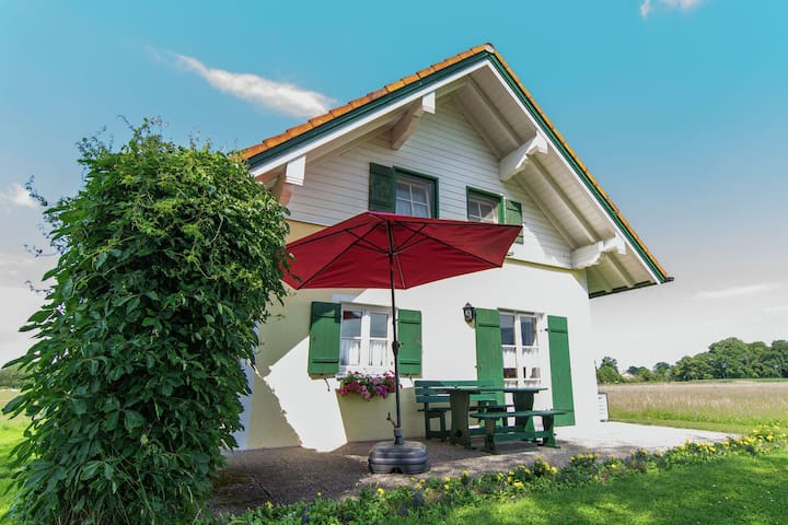 A holiday home for 5 persons near the Chiemsee with a view of the Alps.