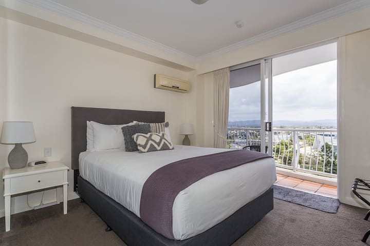 Master bedroom with own balcony  Queen size superior bed luggage rack full size mirrored wardrobe with loads of hangers/shoe storage Room safe air conditioning TV