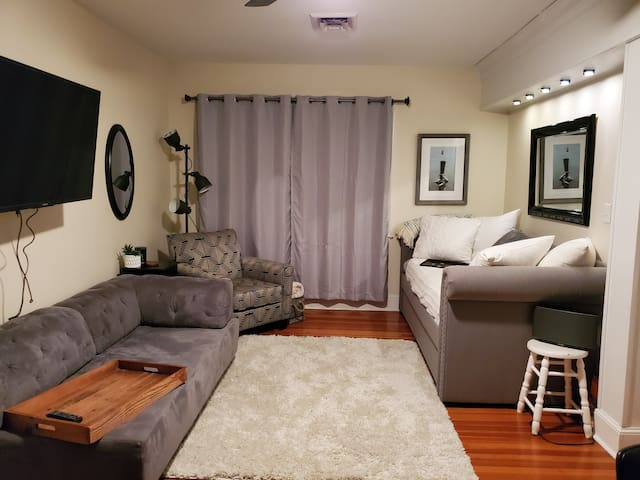 Living area with 3 twin beds.