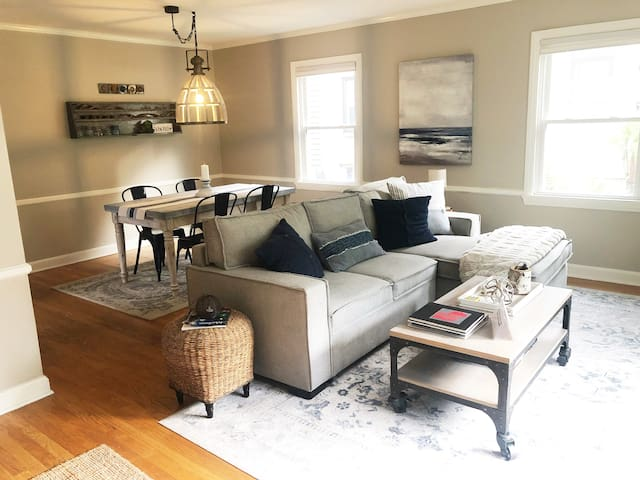 Open floor plan with entryway, living area and dining area