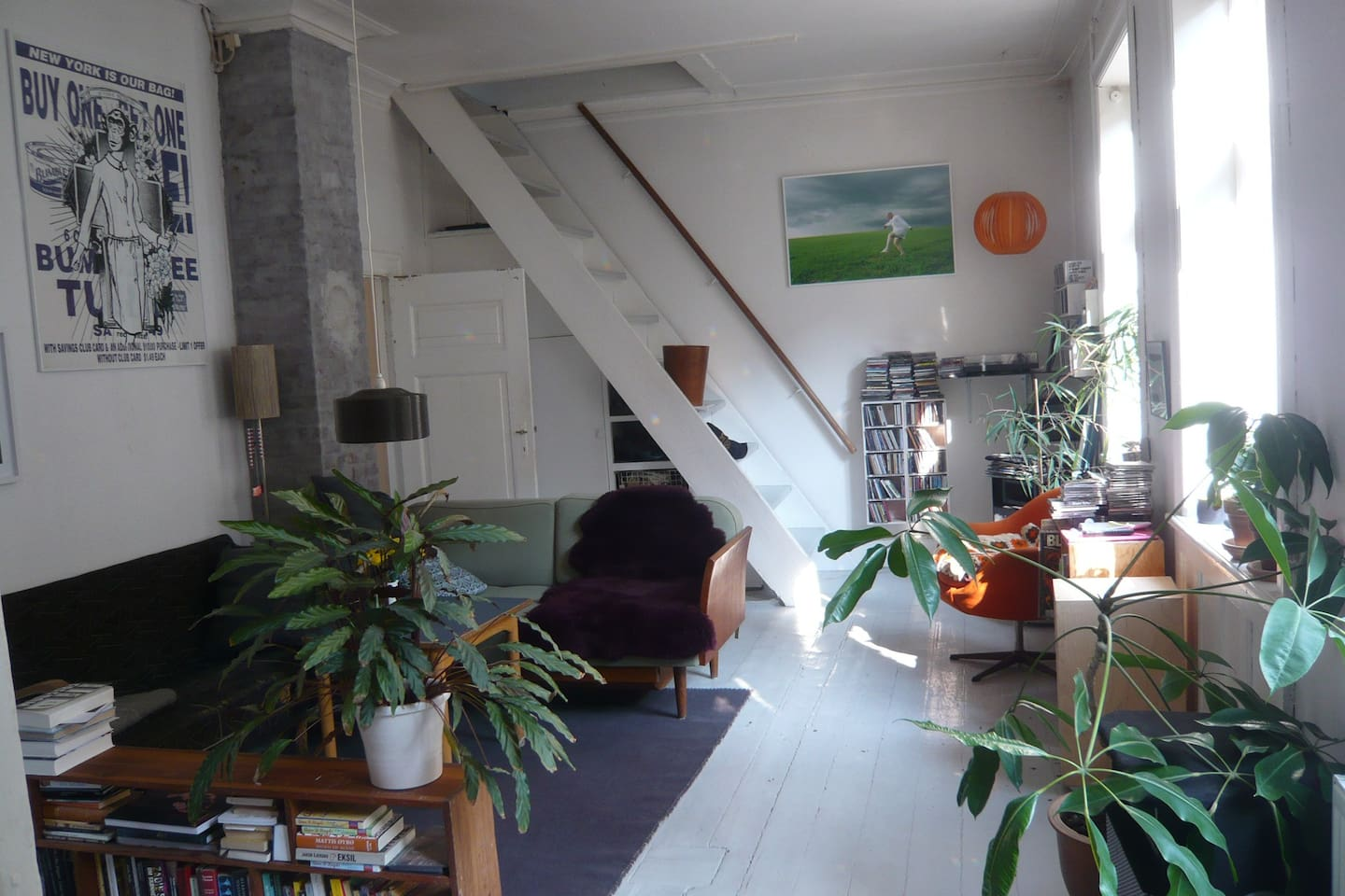 Living room. Stairs and door to bedrooms