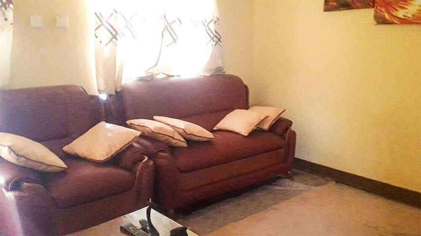 Living room space with 7 seater leather sofa