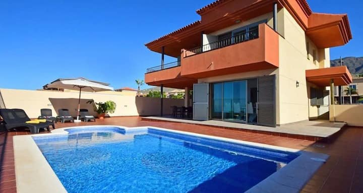 """Holiday Home """"Villa Calima"""" with Mountain View, Sea View, Pool, Balcony Air Conditioning & WiFi; Parking Available in the Street, Pets Allowed"""