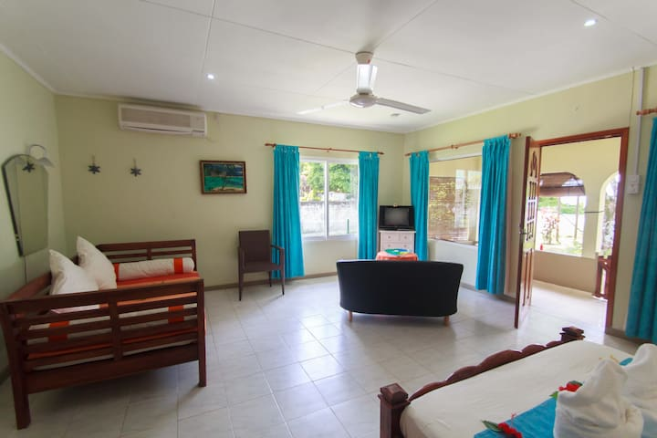 Open suite villa with bed and lounge area combined for easy living