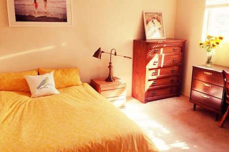 Sunny bedroom in gorgeous beach pad