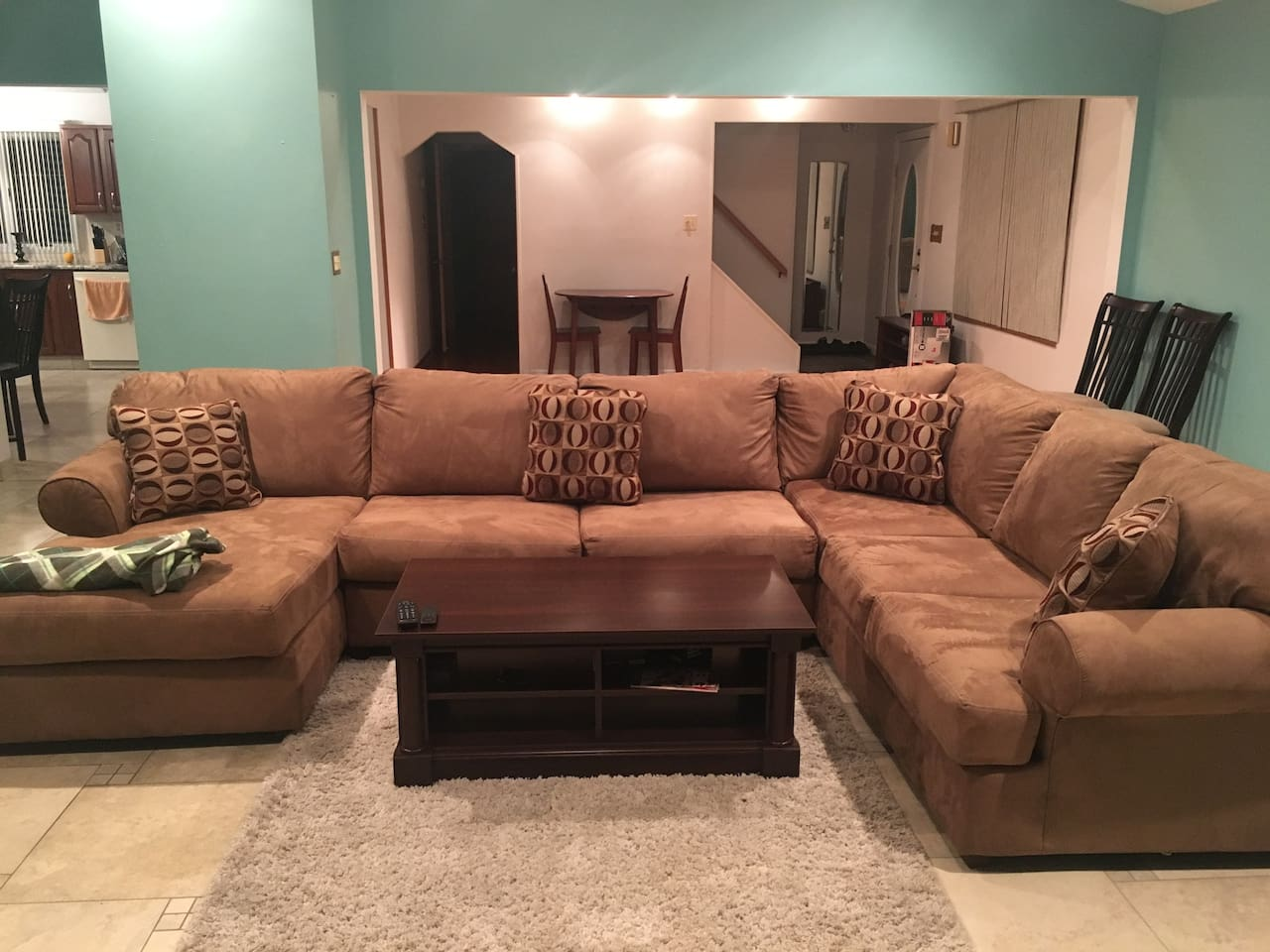 L shaped couch, coffee table, ~65'' TV with Kodi, heated floors
