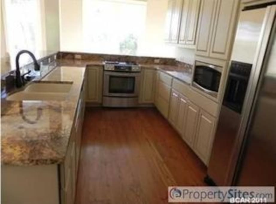 Kitchen with granite counter tops and stainless steel appliances