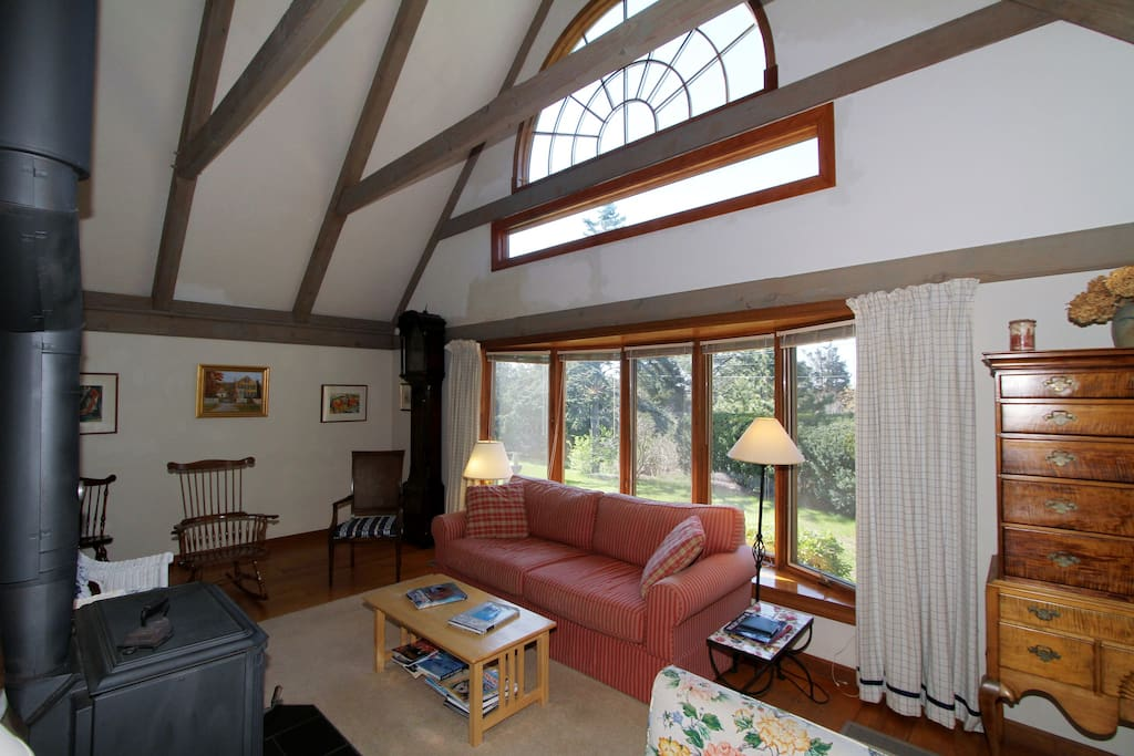 Vaulted ceilings and exposed timber beams feature in the main living room.