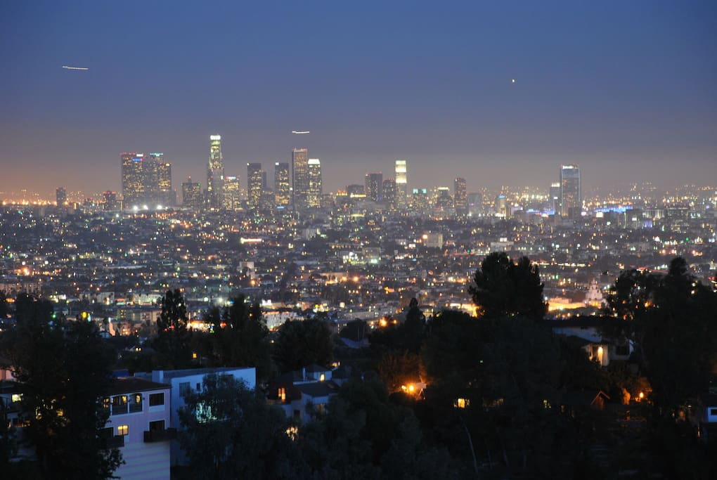 views of downtown Los Angeles from bedroom and private balcony