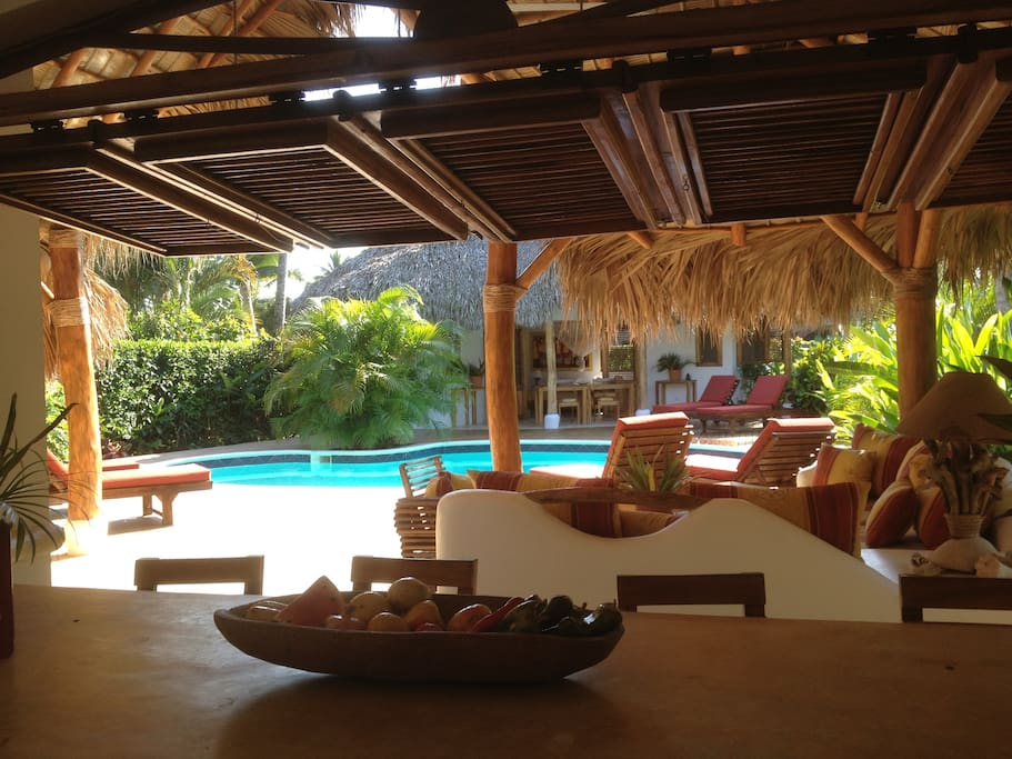 view pool and bungalow from kitchen main house