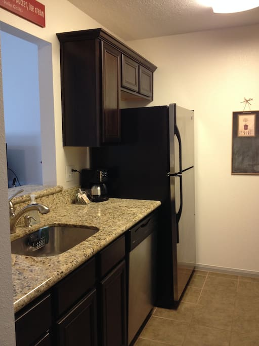 Granite Counters, stainless steel appliances, full dishwasher and stove/oven.