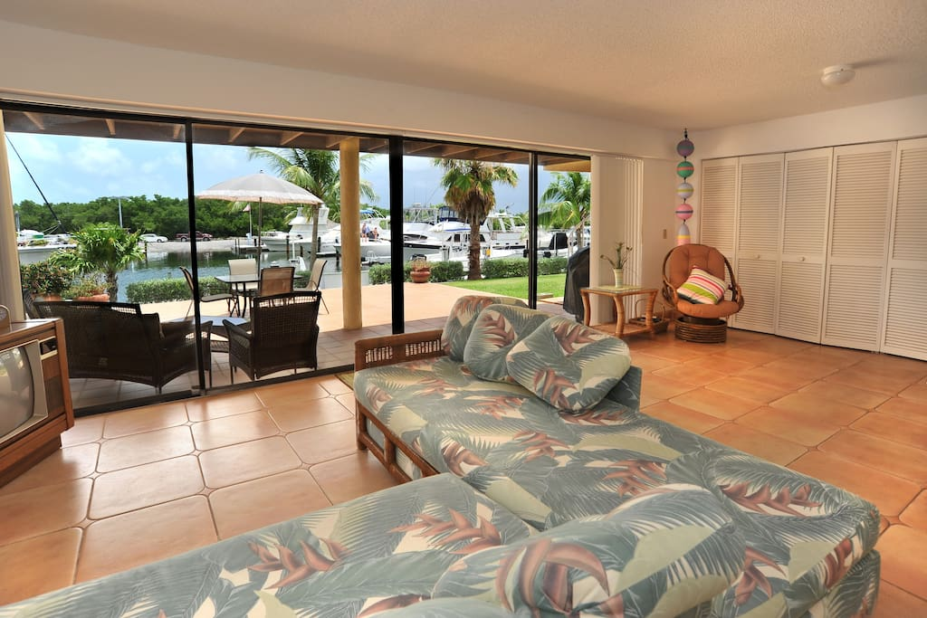 1st floor living area large sliding glass doors open to marina front sun patio with BBQ grill!
