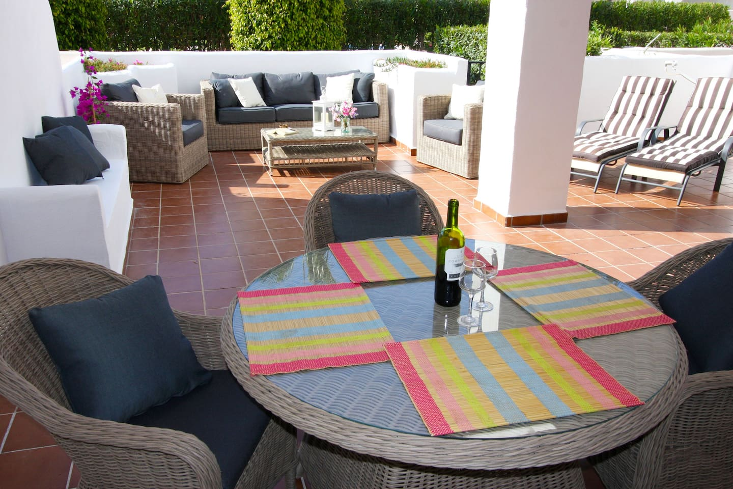 Large terrace with new wicker sofas, table and chairs. 4 sunbeds.