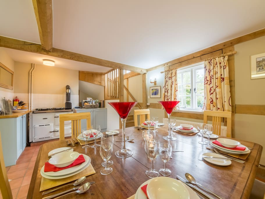 Ground floor: Farmhouse kitchen with Rayburn and dining table
