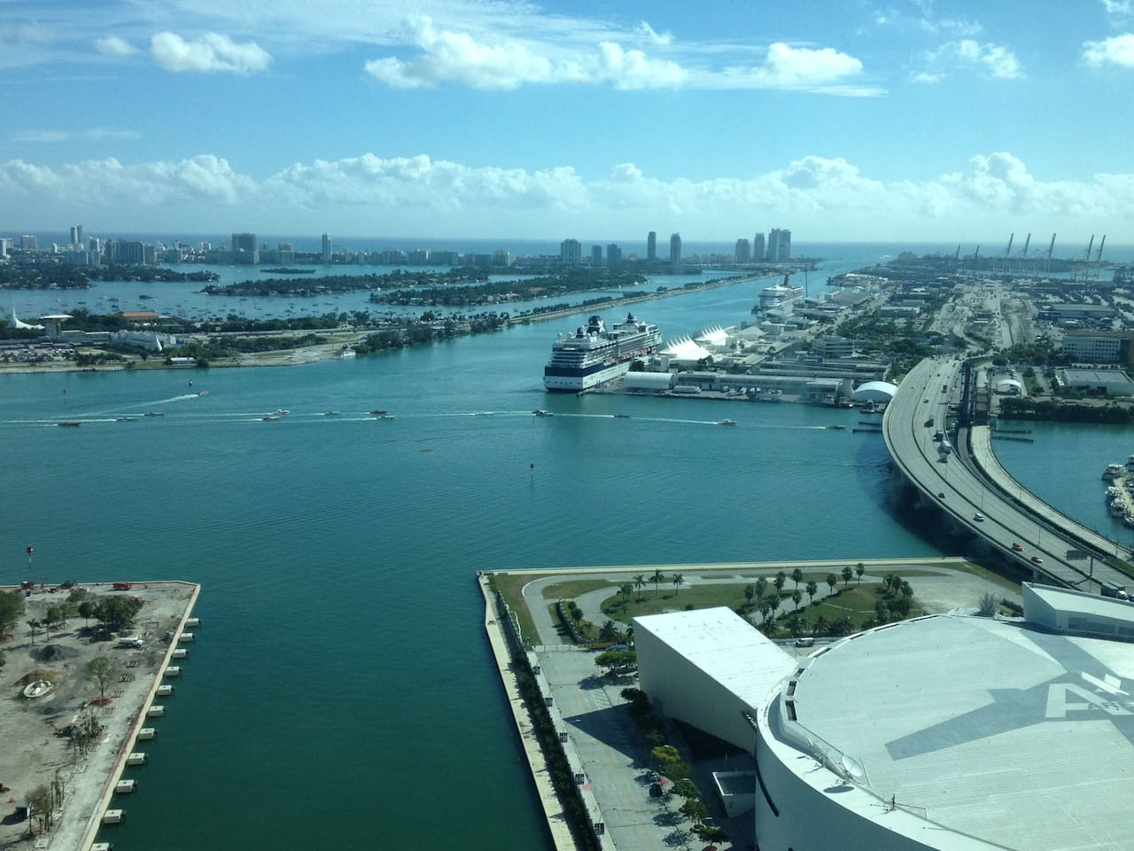 View from the balcony, Overlooking Miami Heat Arena & watch cruises leave the Port of Miami!