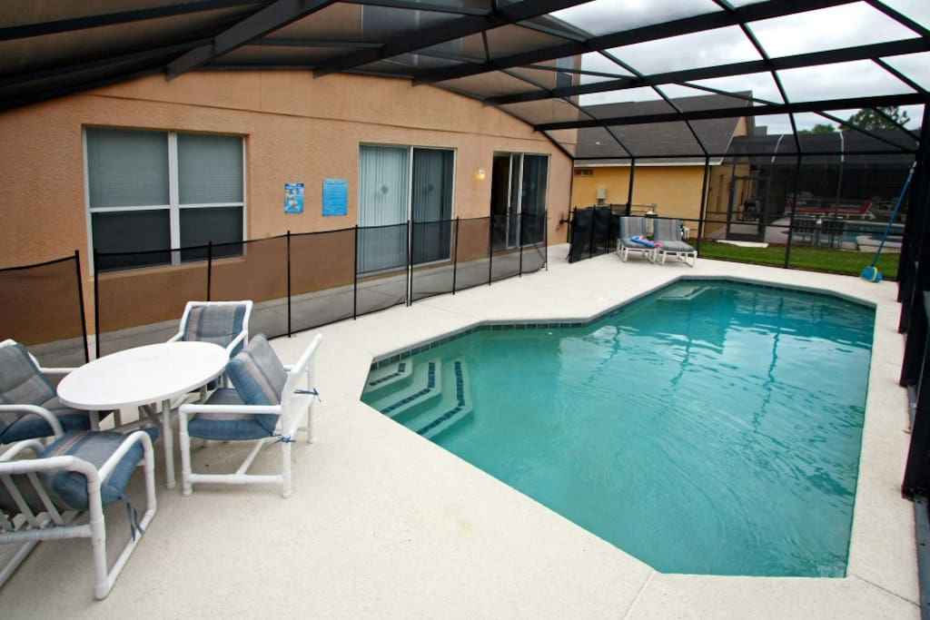 private heated swimming pool facing wooded area