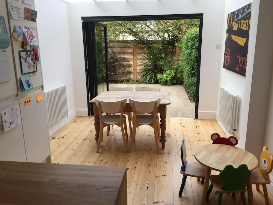 Kitchen / Dining area with bifold doors leading to patio garden