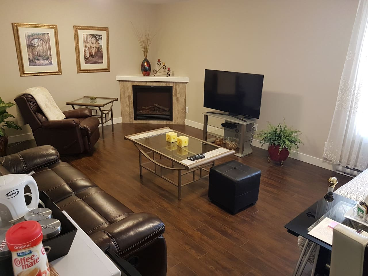 """Family room available  for relaxing or watching Netflix with your host and hostess. 52"""" Smart T.V. Trundle bed available at $ 20.00/ night/ Guest if used."""