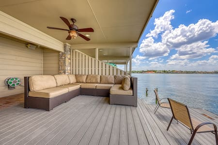 NEW LISTING! Waterfront home w/ a furnished deck & fireplace - dogs welcome!