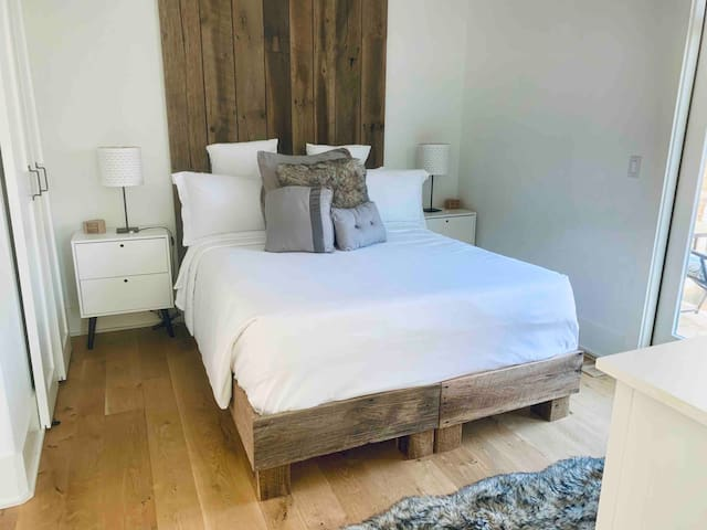 Queen-size bed and ceiling fan. The bathroom is directly accessible from the bedroom (and the foyer). Plus, there is a private balcony with a table, umbrella, and chairs so you can relax and/or entertain while taking in scenic views.