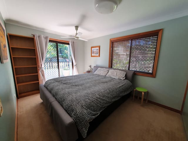 King size bed with views from the bedroom out to the courtyard, the gardens and the pool. Plenty of cupboard storage, plus bedside tables and bookcase.