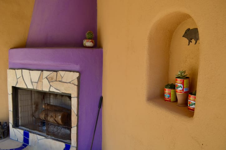 The beehive fireplace is laid with firewood- ready for a cool desert evening.