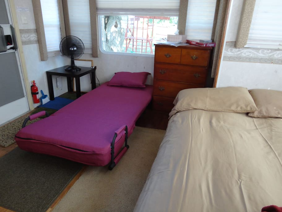 Living area with the double futon bed and single futon chair opened into beds.