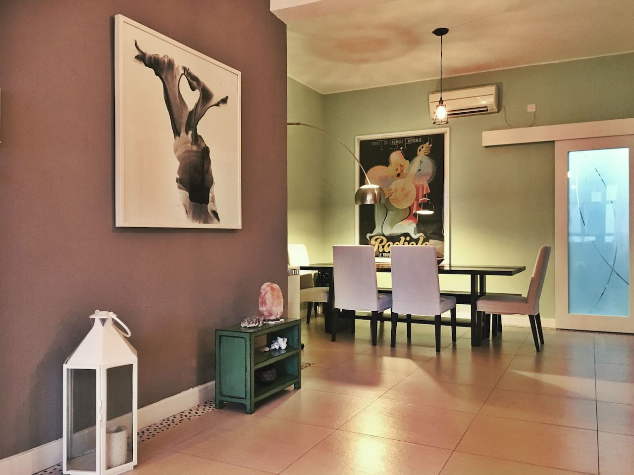 Shared Dining Space Featuring Original Art from China and France