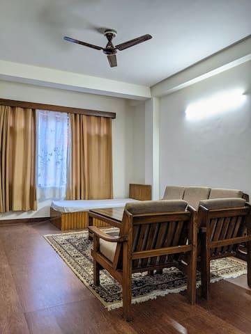 Our living room includes one extra single bed along with the sofas. This space can be used by the family or the group for small gatherings during meals or any other ocassion