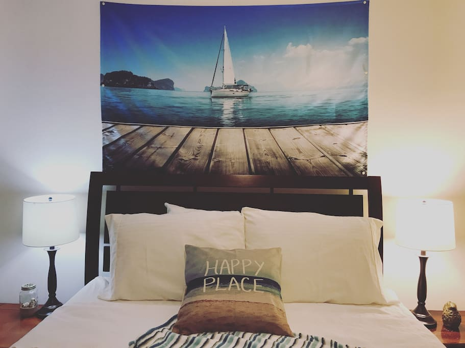 Welcome to Bay room. Sit back, relax, have a good night sleep! Tapestry on the wall evokes calm and serenity. Truly, this can be your happy place away from home!