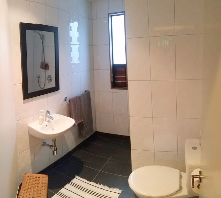 Bathroom with walk-in shower is conveniently adjacent to your bedroom.