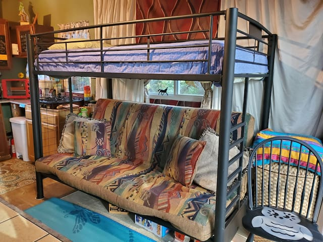 We now have a futon bunk bed on the first floor and sleep 9 people. The loft a queen and 4 twins. Bring your whole family, amazing friends, children's Birthday celebration, or women's sacred getaway.
