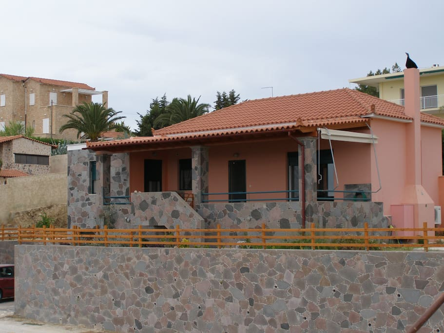 The front of the house featuring the handmade stone fence