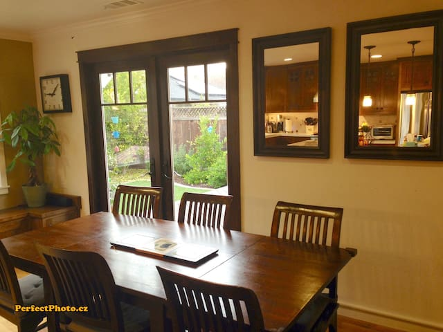 Dining table (seats 8); French doors open to deck
